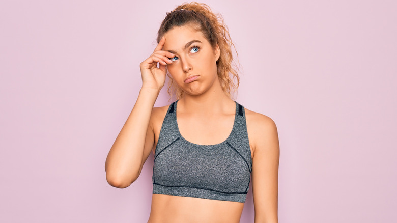 confused woman in workout gear