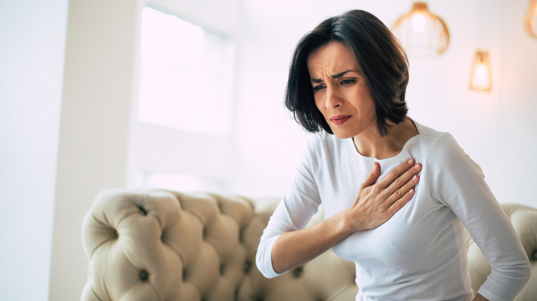 A woman suffers from chest pain