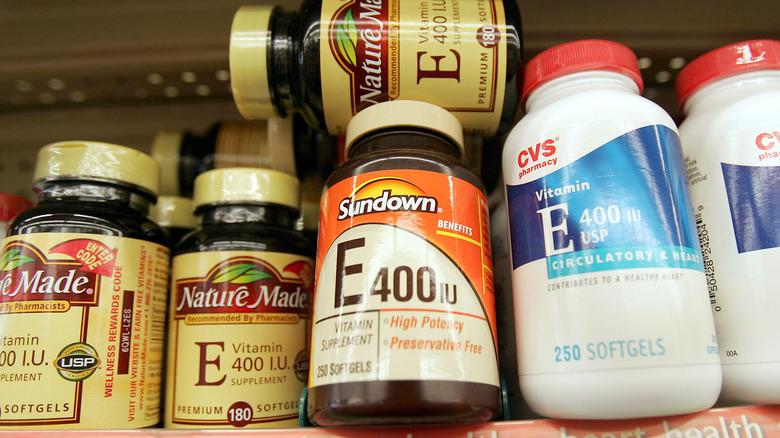 Bottles of vitamin E stacked on a shelf