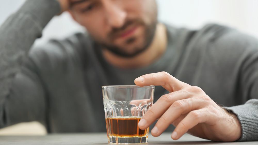 Unhappy drinking man