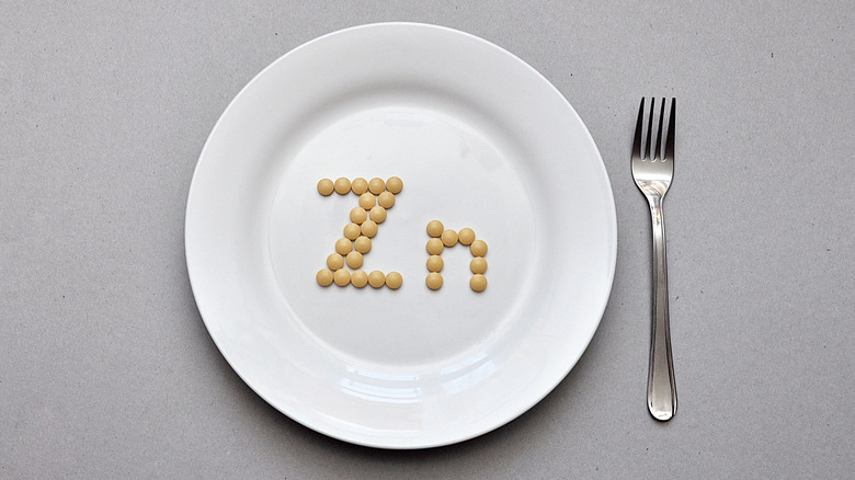 """""""Zn"""" spelled out by supplement pills on a plate"""