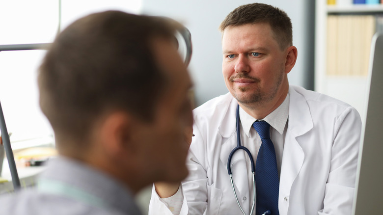 doctor looking at patient in disbelief