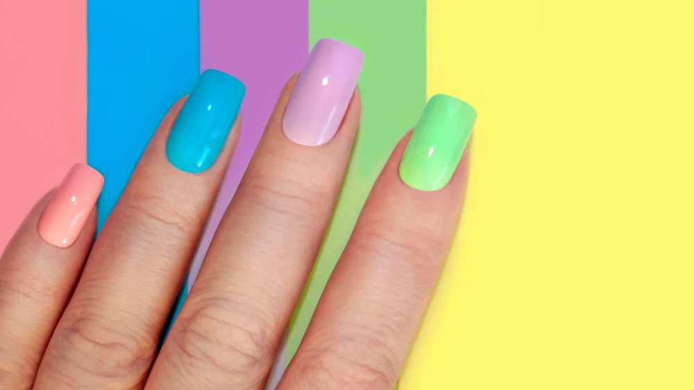 hand with colorful polished nails