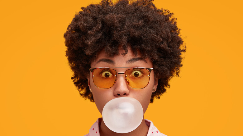 african american woman chewing gum