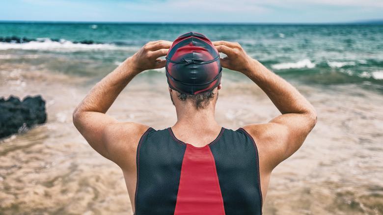 swimmer standing on beach