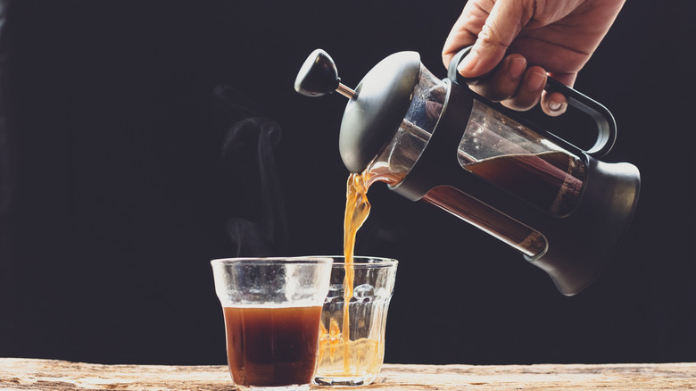 french press coffee maker and coffee in glasses